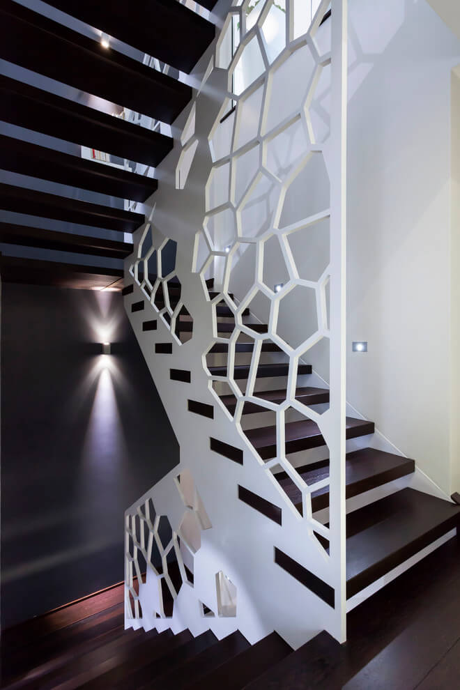 The intricately cut white by marsal rousselot architectes